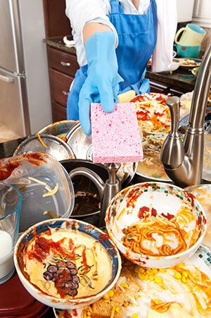 Washing dirty dishes every single night becuase they provide more than enough food for the roaches.
